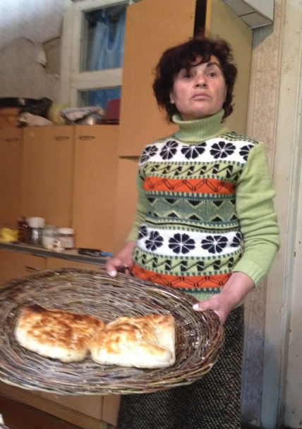 Makvala shows off the finished penovani khachapuri